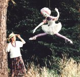 joyce with a scarecrow in a tree